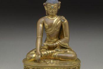 Buddha sitting in vajrasana on double lotus base