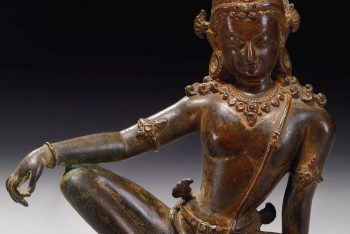A COPPER ALLOY FIGURE OF INDRA