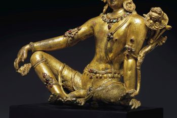 A GILT BRONZE SEATED FIGURE OF INDRA