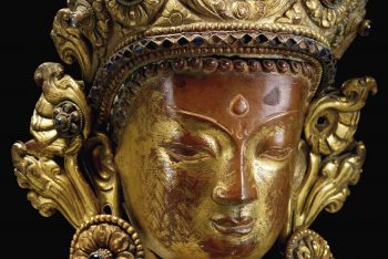 A GILT-COPPER EMBOSSED BUST OF A BODHISATTVA