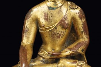 A GILT-COPPER FIGURE OF BUDDHA SHAKYAMUNI