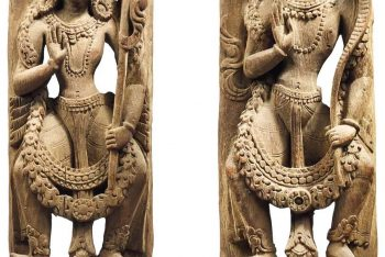 PAIR OF SCULPTED WOODEN UPRIGHTS REPRESENTING GUARDIANS
