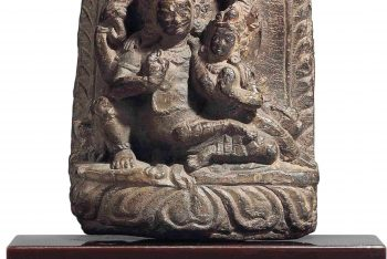 A STONE STELE OF BHAIRAVA AND HIS CONSORT