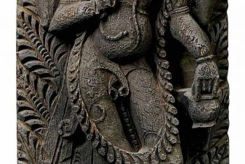 A WOOD STRUT DEPICTING THE FOUR-ARMED BHAIRAVA
