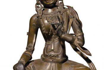 A bronze repousse figure of a Bodhisattva