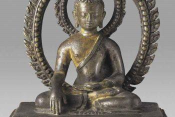 A copper figure of Buddha