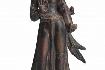 A copper figure of Tara