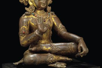 A gilt bronze figure of Amoghasiddhi