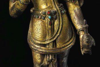 A gilt bronze figure of Maitreya
