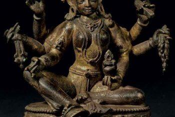 A gilt bronze figure of Vasudhara