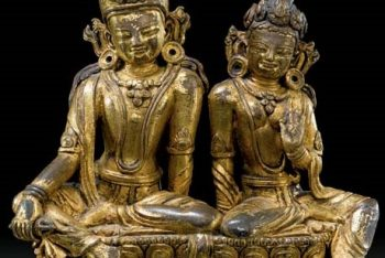 A gilt bronze group of Indra and Indrani on a lotus throne
