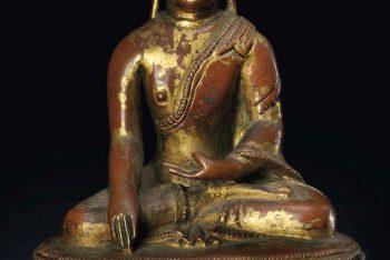 A gilt copper figure of Buddha