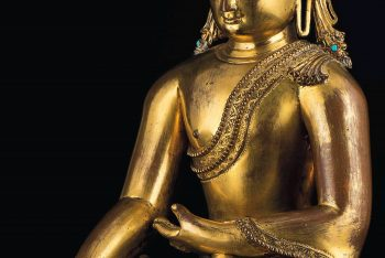 A gilt copper figure of Crowned Buddha