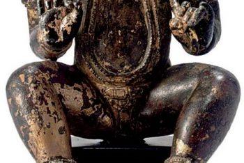 A gilt copper figure of Kubera