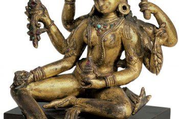 A gilt copper figure of Vasudhara