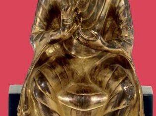 A gilt copper figure of the Teaching Buddha
