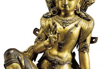 A gilt copper repousse figure of a Bodhisattva