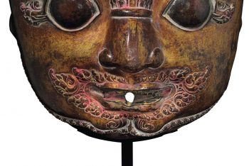 A gilt copper repousse mask of Bhairava