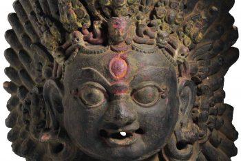 A polychromed terracotta mask of Bhairava