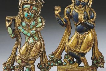 TWO TURQUOISE AND LAPIS-LAZULI INLAID REPOUSSE GILT-COPPER ORNAMENTS DEPICTING VENUGOPALA