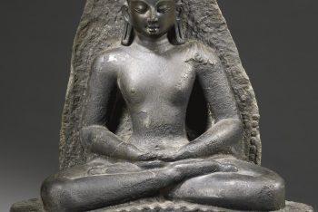 A BLACK STONE FIGURE OF BUDDHA SHAKYAMUNI