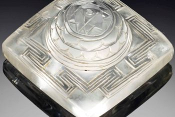 A CARVED ROCK CRYSTAL YANTRA