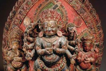 A LARGE POLYCHROME WOOD STELE CARVED WITH BHAIRAVA