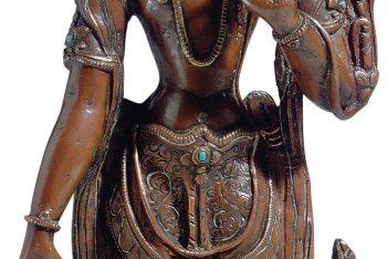 A NEPALESE SILVER INLAID COPPER FIGURE OF AVALOKITESHVARA
