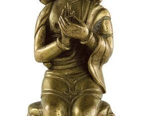 A SMALL INDIAN GILT COPPER FIGURE OF THE TEACHING BUDDHA