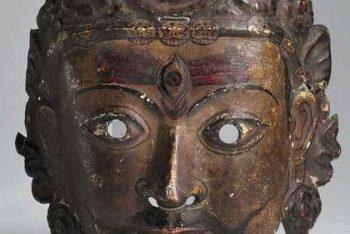 A copper repoussé mask of a Shaivite deity