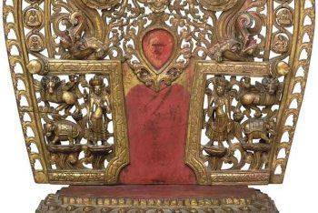 A gilt and polychromed wooden torana and pedestal