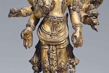 A gilt bronze figure of Amoghapasha