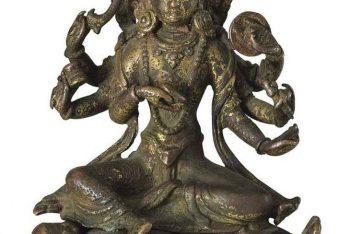 A gilt bronze figure of Kali