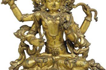 A gilt bronze figure of Manjushri Namasangiti