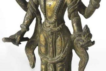 A gilt bronze figure of Vishnu