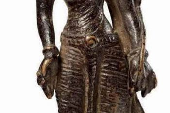 A gilt copper figure of Tara