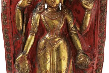 A large gilt and polychromed copper repousse plaque of Harihara