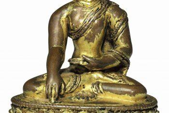 A small gilt bronze figure of Buddha