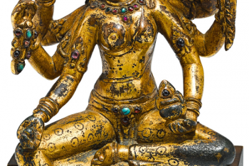 A RARE GILT-COPPER FIGURE OF VASUDHARA