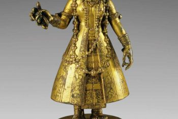 A GILT BRONZE FIGURE OF DONOR