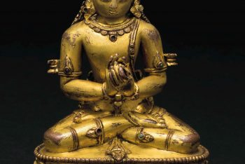 A gilt bronze figure of Vairochana