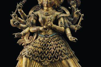 A large gilt copper repousse figure of Durga