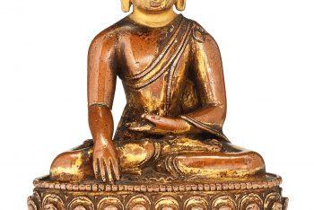 A GILT-BRONZE FIGURE OF A SEATED BUDDHA