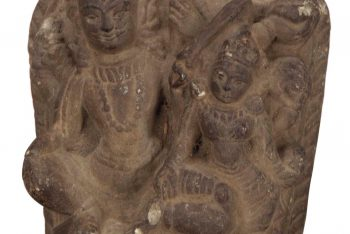 A SMALL NEPALESE STONE STELE OF SHIVA AND PARVATI
