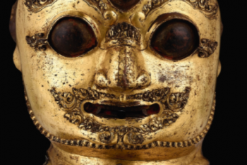 A FINELY CAST GILT-COPPER REPOUSSE MASK OF BHAIRAVA