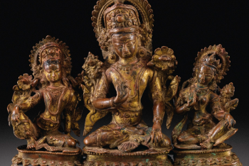 A GILT-COPPER ALLOY TRIAD OF INDRA AND CONSORTS, NEPAL, 16TH CENTURY