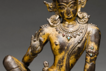 A GILT COPPER FIGURE OF INDRA WITH INSET SEMI-PRECIOUS STONES AND TURQUOISE BLUE PASTE