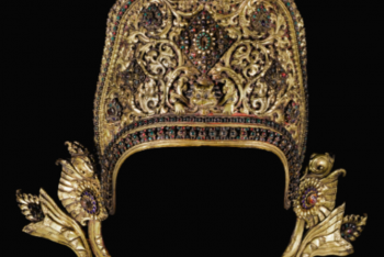 A GILT-COPPER REPOUSSÉ CROWN OF INDRA INLAID WITH PASTE AND SEMI-PRECIOUS STONES Nepal, 17th Century