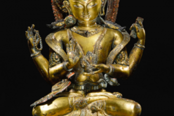 A GILT-COPPER REPOUSSÉ FIGURE OF AVALOKITESHVARA Nepal, circa 16th Century