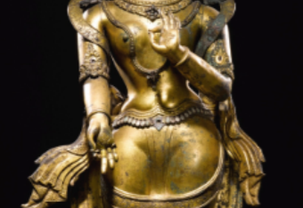 A GILT-COPPER REPOUSSÉ FIGURE OF TARA Nepal, 16th / 17th Century